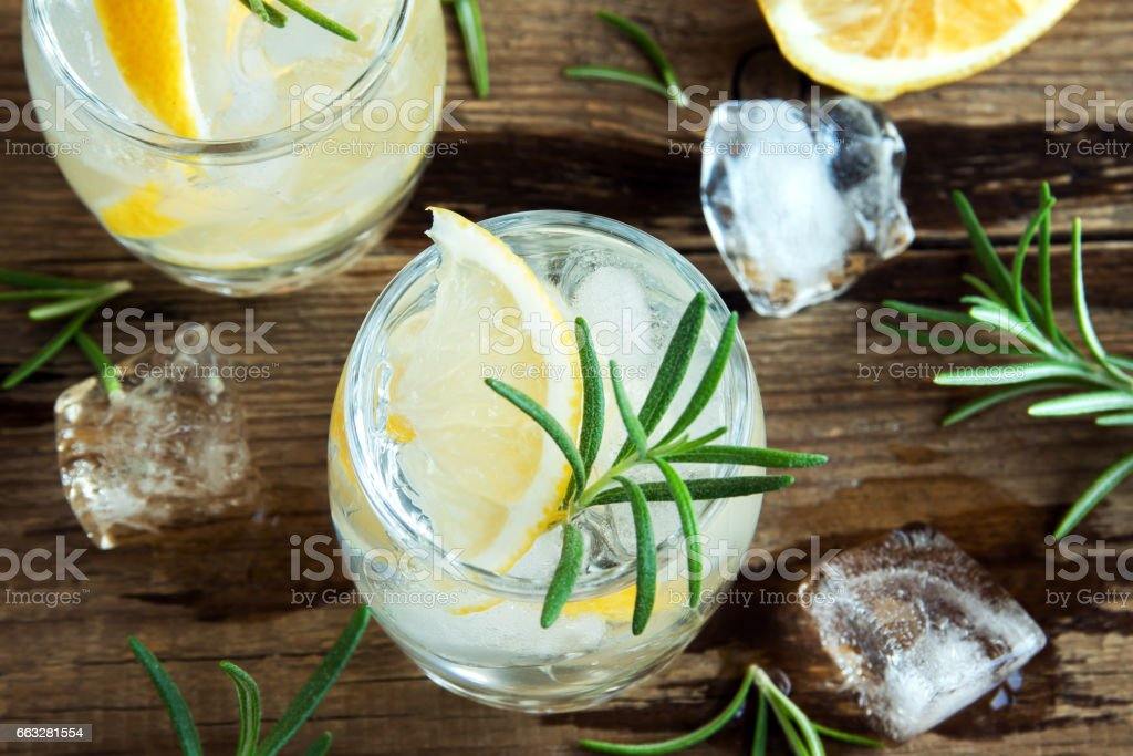 gin tonic cocktail with lemon, rosemary stock photo