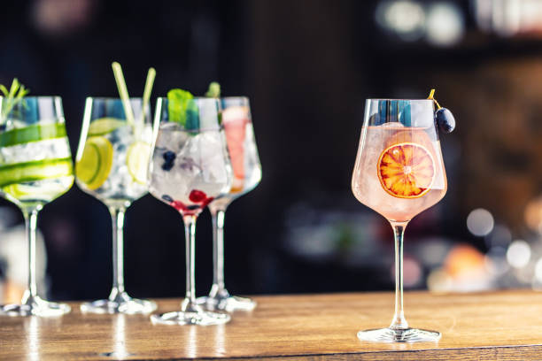 Gin tonic cocktails in wine glasses on bar counter in pup or restaurant stock photo