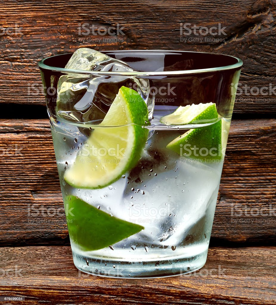 Gin tonic or vodka on wooden table and background royalty-free stock photo