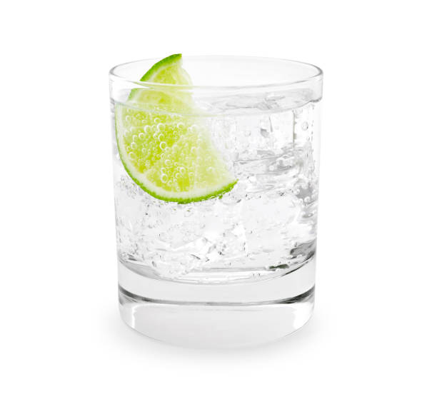 Gin Tonic Gin tonic with lime slice isolated on white vodka stock pictures, royalty-free photos & images