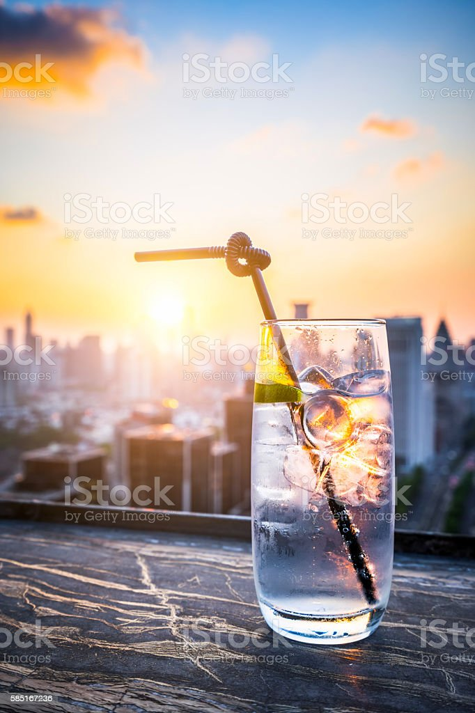 Gin Tonic with Blurred City Background stock photo