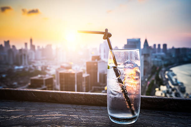 Gin Tonic with Blurred City Background - Photo