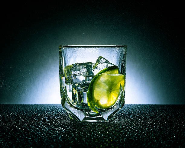 Gin & Tonic with ice and lime stock photo