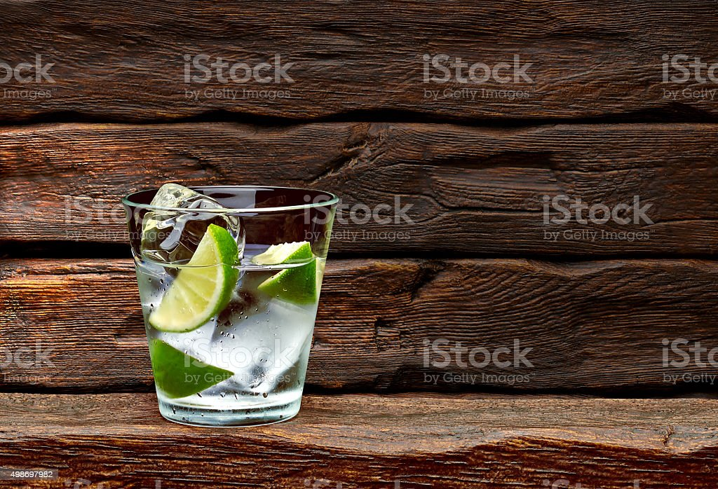 Gin tonic with lime wedges stock photo