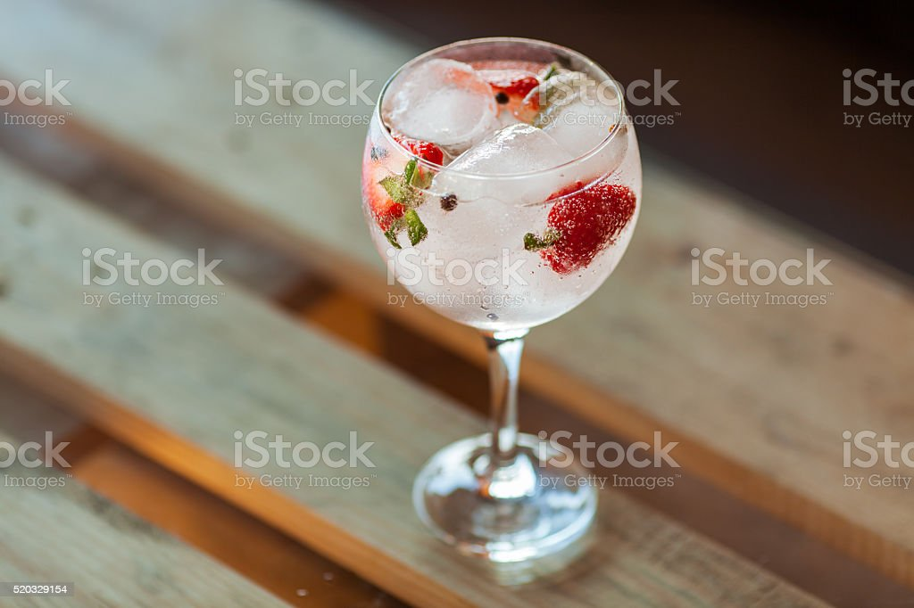 Gin Tonic with strawberries stock photo