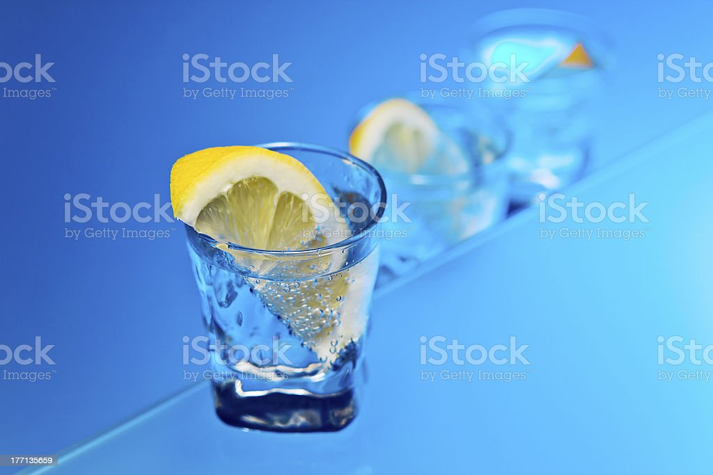 gin with lemon on a glass table royalty-free stock photo