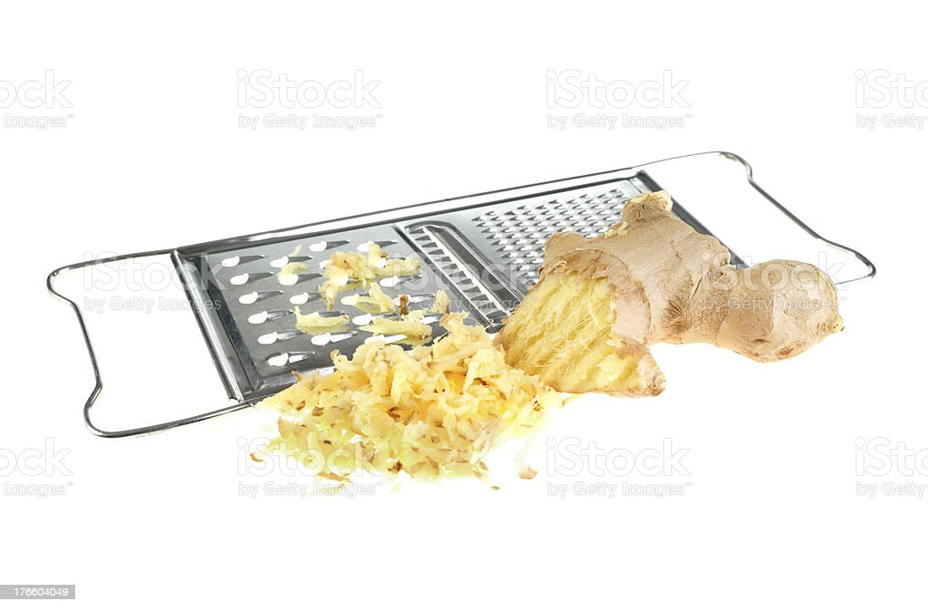 Ginger and kitchen grater isolated on white background stock photo