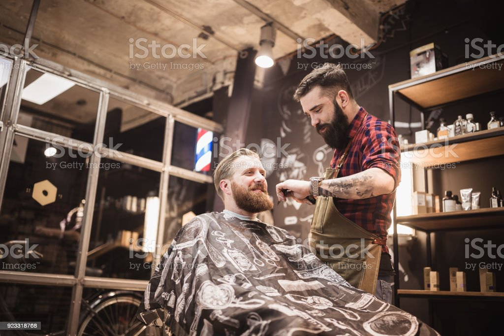 Ginger, bearded guy at the barber shop stock photo
