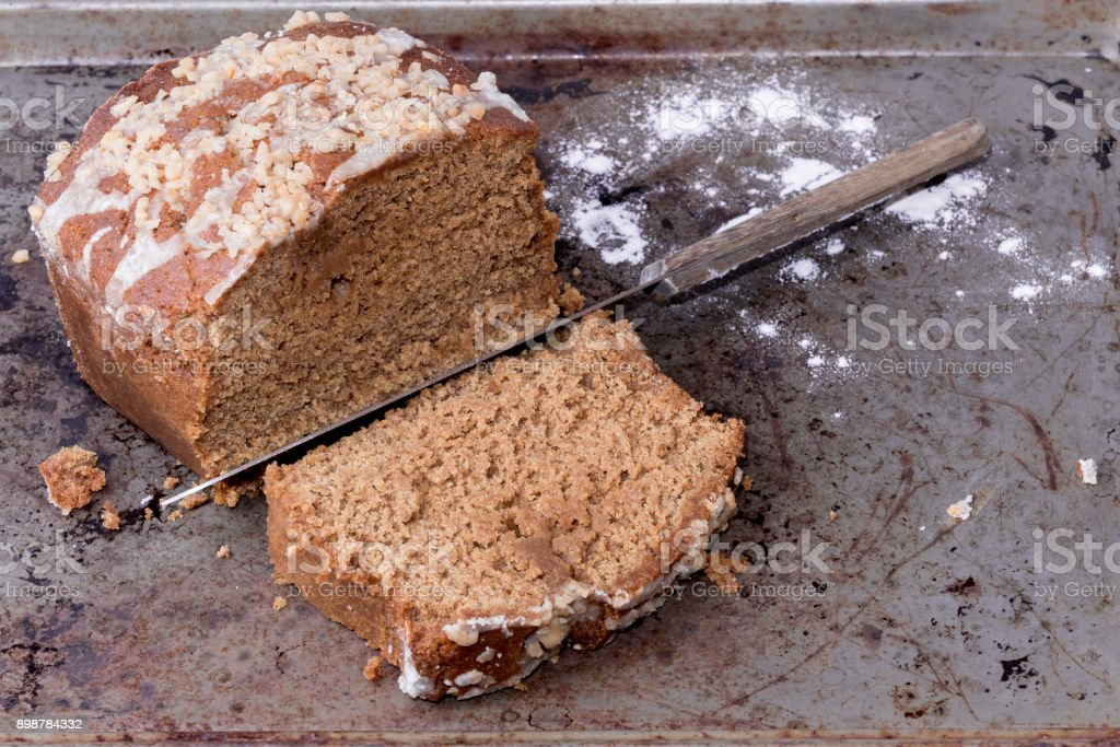 Ginger bread loaf being sliced stock photo