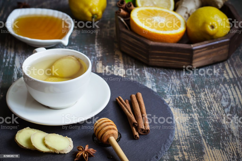 Ginger hot  immunity boosting Vitamin natural drink With citrus, honey and cinnamon and ingredients stock photo