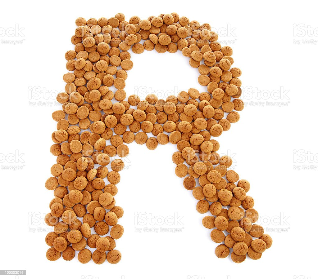 Ginger nuts, pepernoten, in the shape of letter R royalty-free stock photo