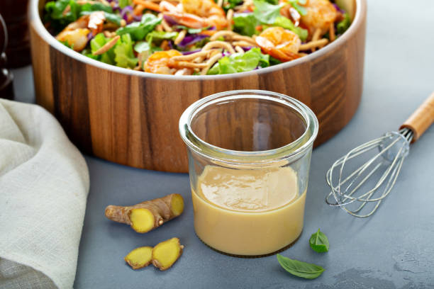 Ginger peanut asian salad dressing Ginger peanut asian salad dressing with a shrimp salad salad dressing stock pictures, royalty-free photos & images