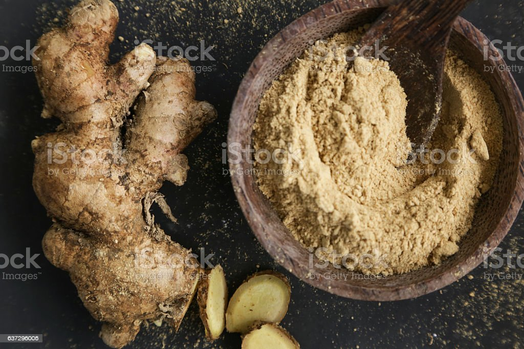 Ginger root and ginger powder stock photo