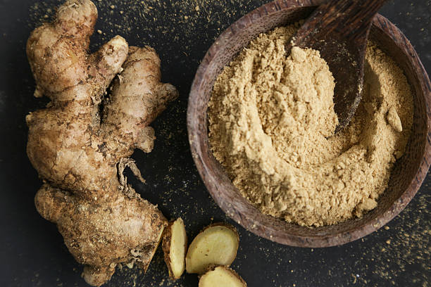 ginger root and ginger powder - ginger stock photos and pictures