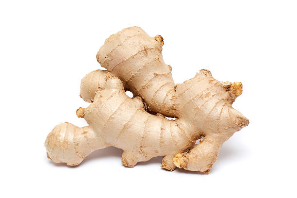ginger root isolated on white background - ginger stock photos and pictures