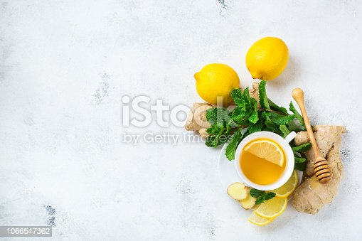 istock Ginger tea in a cup for flu cold winter days 1066547362