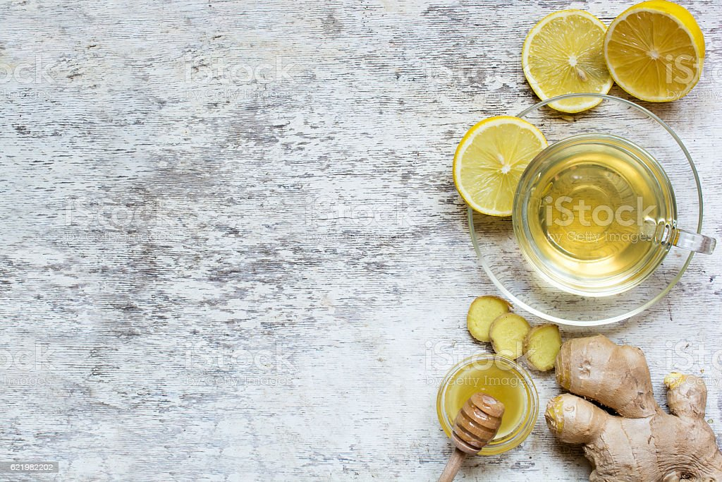 ginger tea in transparent cup on rustic wooden background stock photo