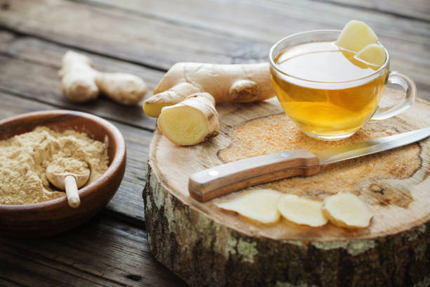 ginger tea on old wooden background stock photo