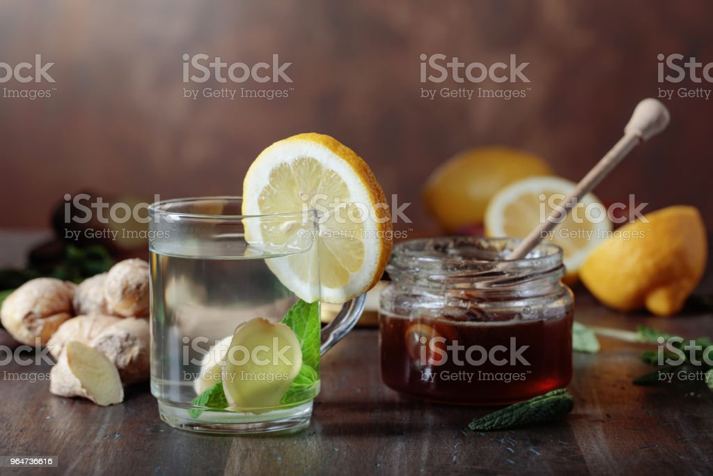 Ginger tea with honey , lemon and mint on old wooden table . royalty-free stock photo