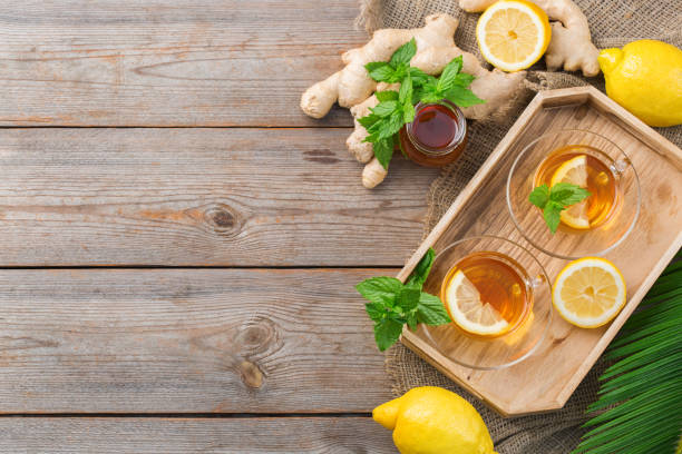 Ginger tea with lemon, mint and honey for flu cold stock photo