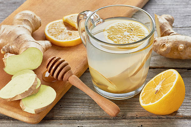Ginger tee with lemon and honey on wooden table stock photo