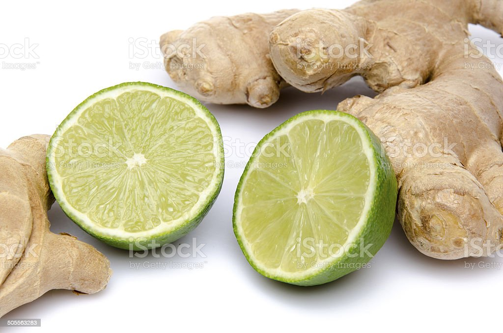 Ginger with a lime cut in half stock photo