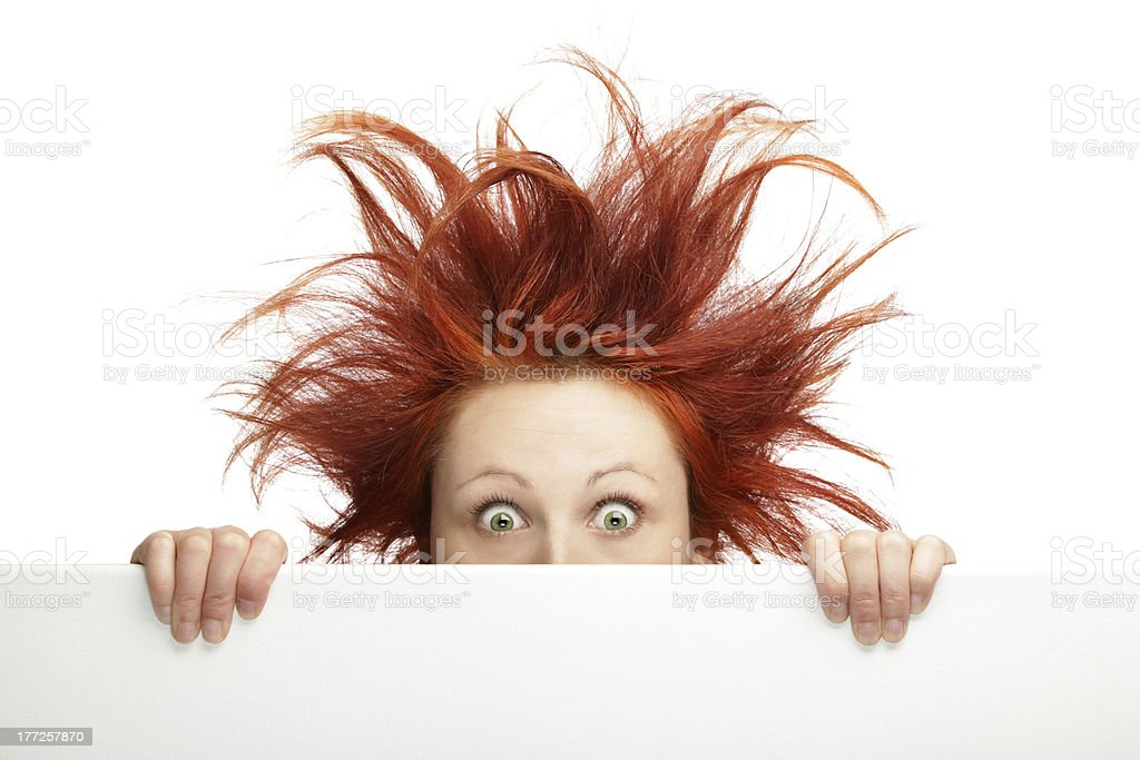 Ginger woman having bad hair day holding a blank board stock photo