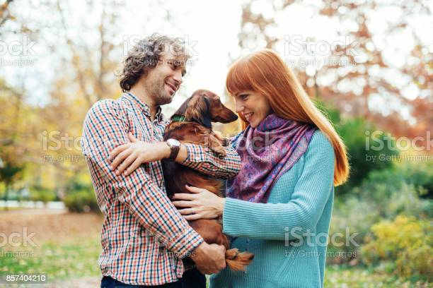 Ginger woman petting dachshund dog picture id857404210?b=1&k=6&m=857404210&s=612x612&h=pepafk1zkrv bu9ixnbsq0ktrmevxfra2hhhrrxoi4s=
