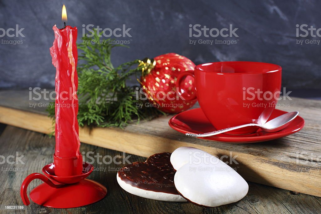 Gingerbread, candle and Christmas ball. royalty-free stock photo