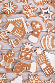 Gingerbread Christmas cookies full frame on white rustic wooden table. The cookies are homemade made by me and are unique and can not be found anywhere.