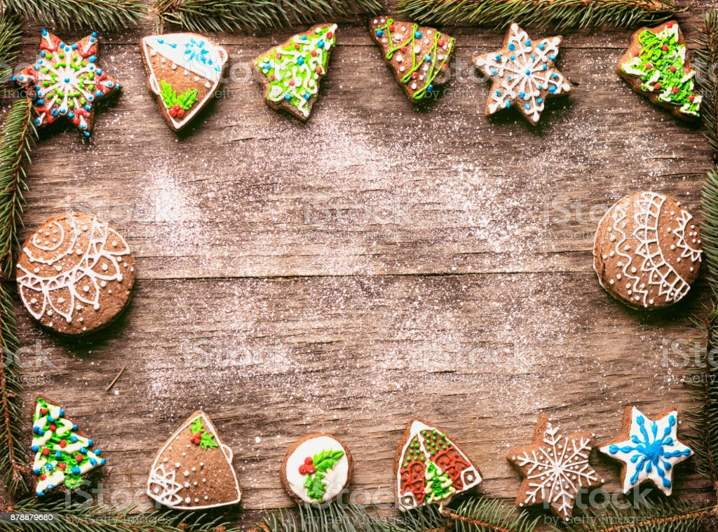 Gingerbread Christmas cookies pine branches frame on wooden table stock photo
