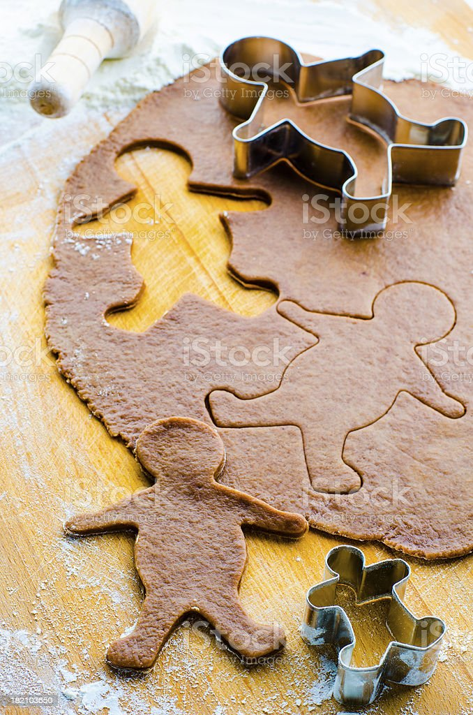 gingerbread cookie dough with men stock photo