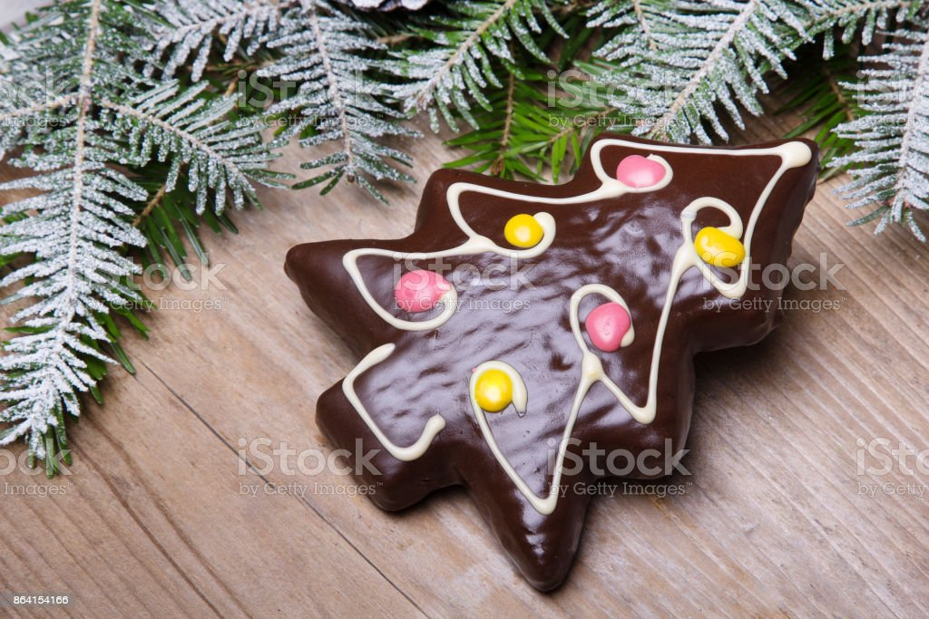 Gingerbread cookie in the shape of Christmas trees on wooden background, copy space royalty-free stock photo
