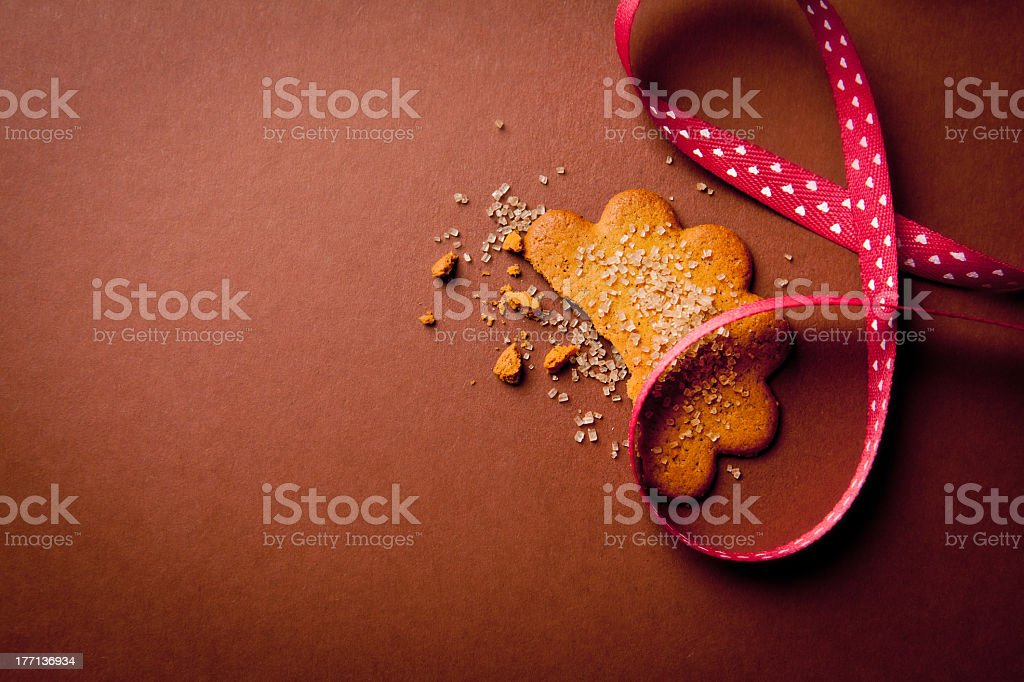 Gingerbread cookie with brown sugar and ribbon stock photo