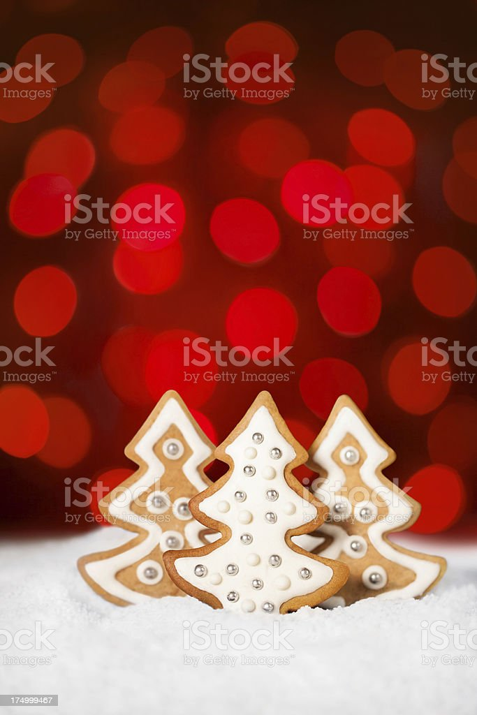 Gingerbread cookies against red sparkling background royalty-free stock photo