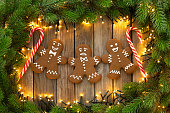 Gingerbread cookies and christmas Decoration on wooden rustic table