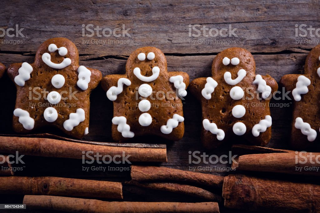 Gingerbread Cookies And Cinnamon Sticks Arranged On Wooden Plank
