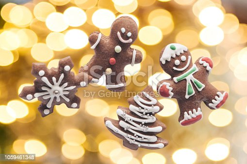 istock Gingerbread cookies on the background of Christmas lights. 1059461348