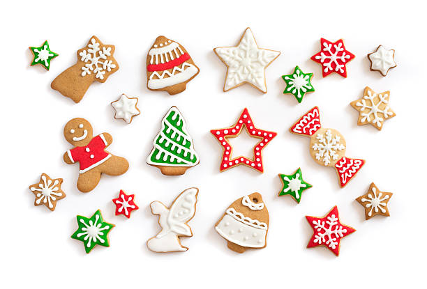 gingerbread cookies on white background - christmas cookies stock pictures, royalty-free photos & images