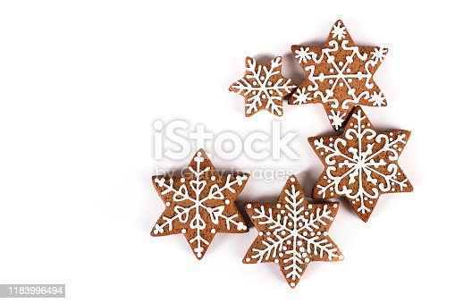 Group of various gingerbread cookies in snowflake shape isolated on white background.
