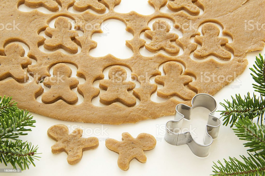 Gingerbread dough for Christmas cookies and cookie cutters. stock photo
