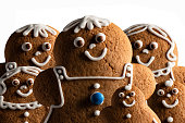 Gingerbread family concept. Macro closeup food and Christmas background.