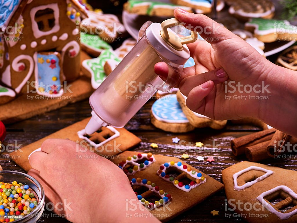 Gingerbread hause making by child hands. stock photo