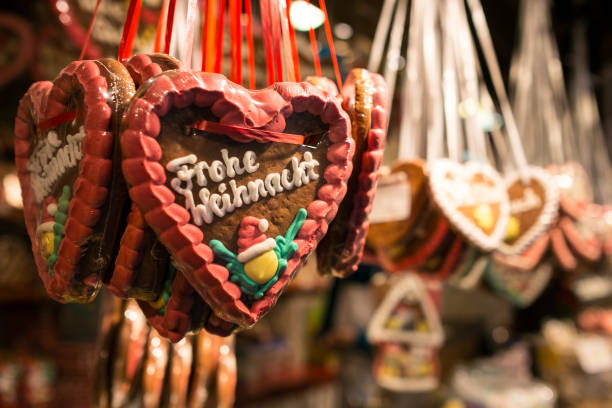 Gingerbread heart as sweet with Frohe Weihnacht stock photo