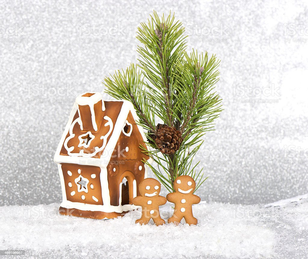 gingerbread house and gingerbread men  in the snow royalty-free stock photo