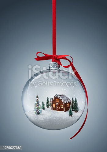 istock Gingerbread house in transparent christmas ball 1079027382