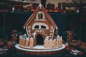 Noel Ginger bread houses on whipped cream for snow effect