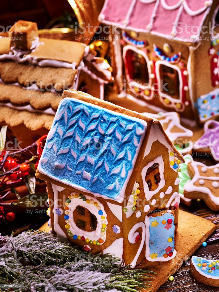 Gingerbread House with blue roof in foreground. stock photo