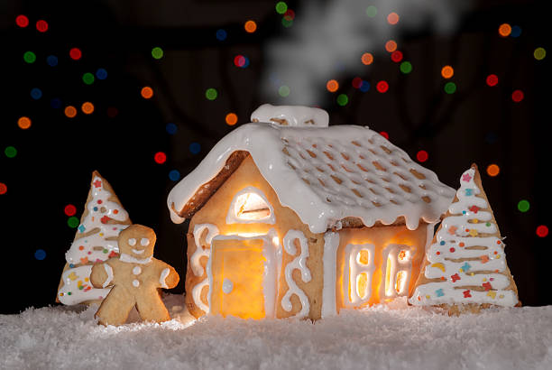 Gingerbread house with gingerbread man stock photo