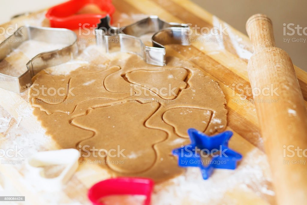 Gingerbread in the shape of a stylized human and other shapes. stock photo